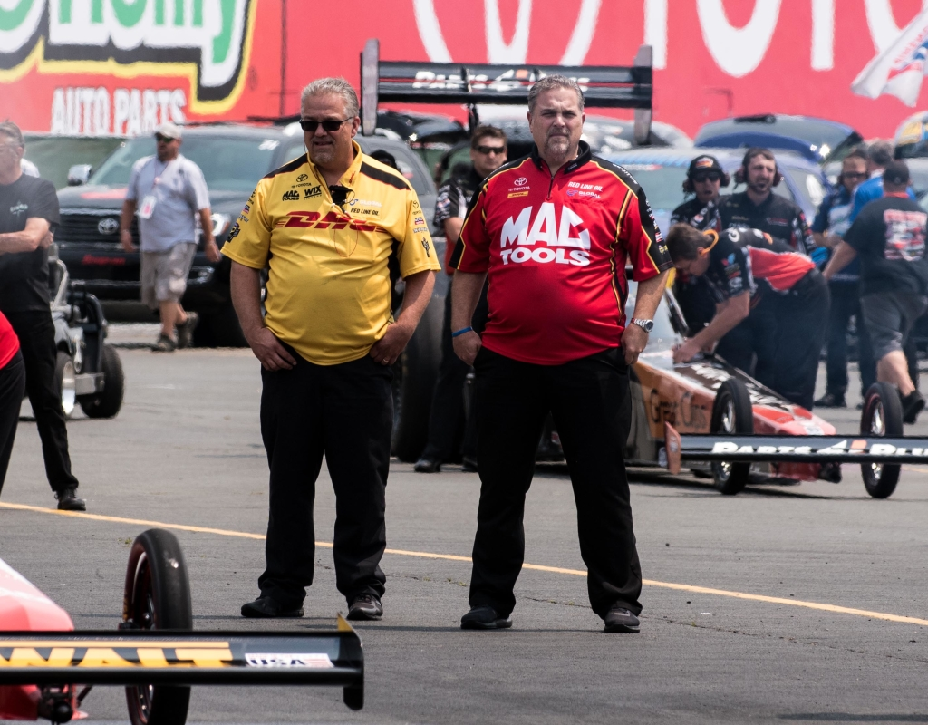Brothers and fellow Crew Chiefs Jon (L) and Jim( R) Oberhofer survey the track conditions during qualifying at the Toyota NHRA Sonoma Nationals