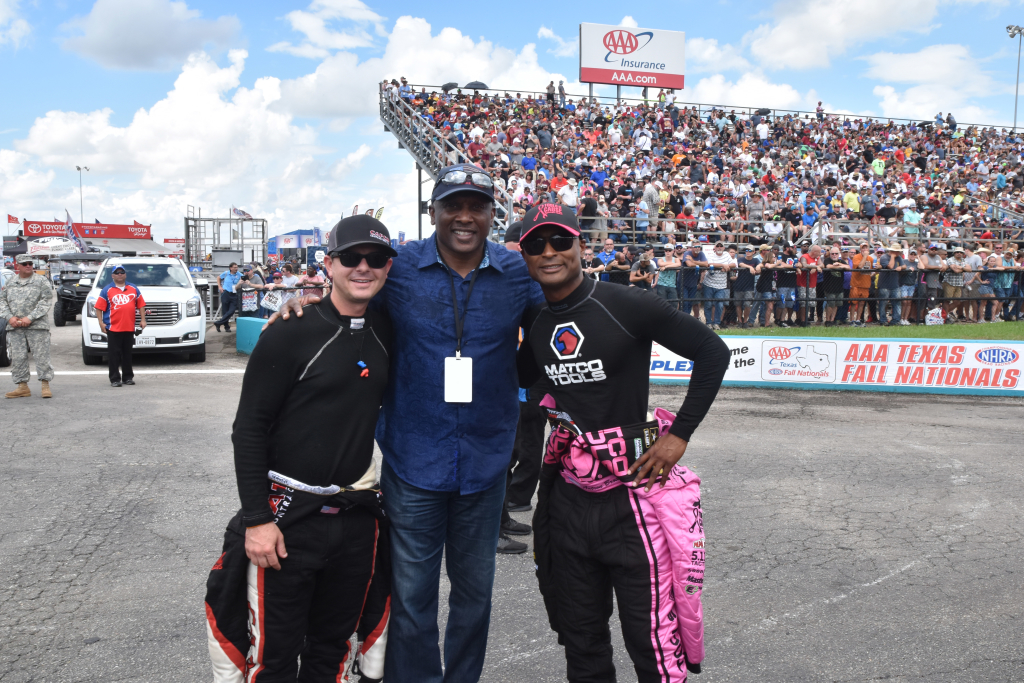 Top Fuel World Champions Steve Torrence (L) and Antron Brown ( R) taking in the action with NFL Hall of Famer Tim Brown