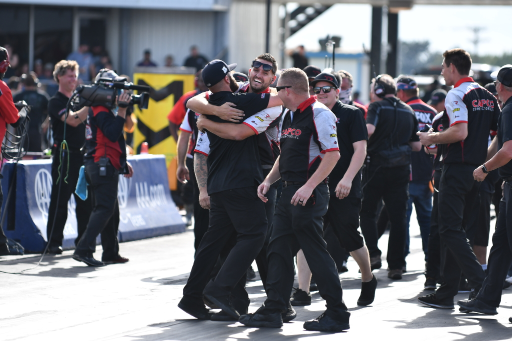 Steve Torrence's team celebrate winning the NHRA AAA Nationals