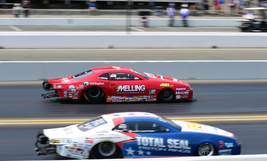 New Orleans resident and former Pro Stock World Champion Erica Enders races past Matt Hartford during round 1 Pro Stock eliminations