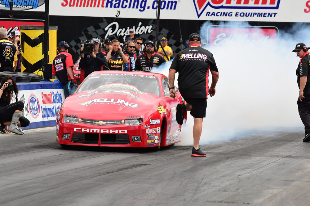 New Orleans resident Erica Enders completes the burnout under the direction of crew chief Richard Freeman. Enders would go on to finish in the Runner Up position, narrowly losing in the final to Tanner Gray