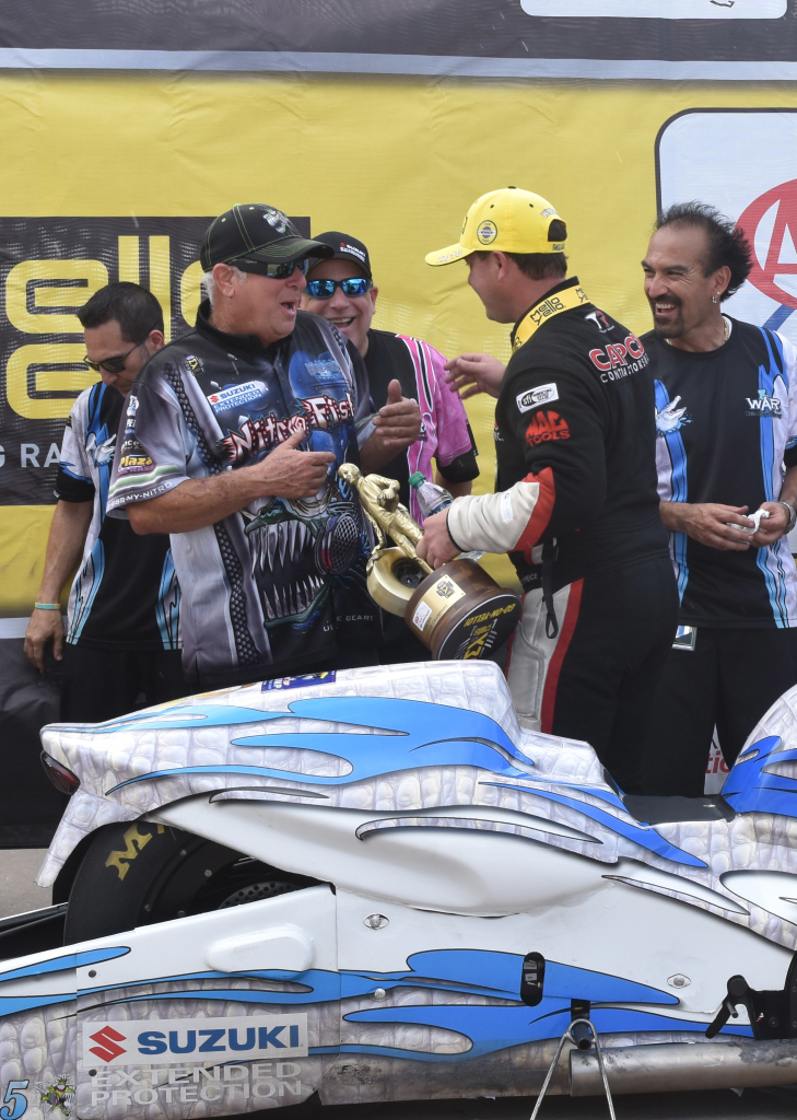 Gary Tonglet, PSM winner LE Tonglet's father, receives congratulations from Top Fuel Champ Steve Torrence following Gary's son LE's win