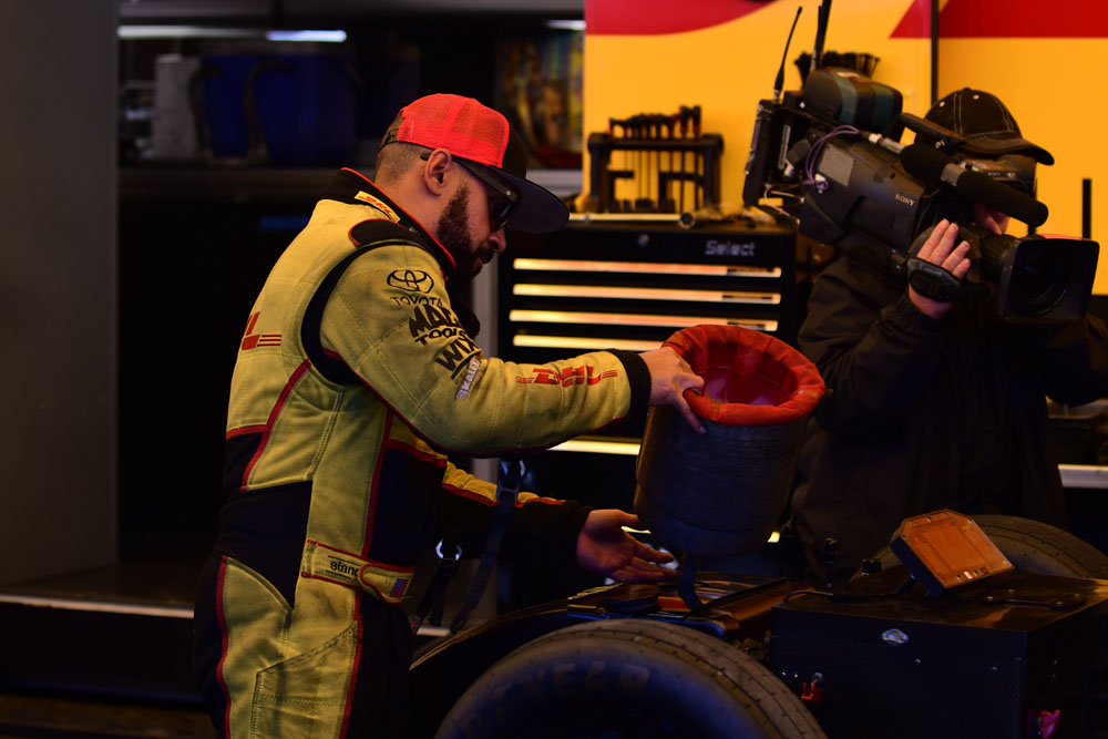 JR Todd fills up his DHL Toyota Camry with nitromethane prior to his final round matchup with Robert Hight