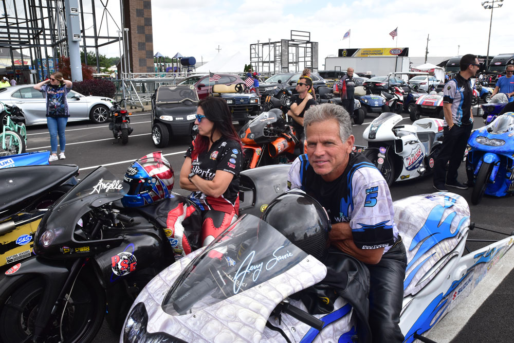 Jerry Savoie of Cut Off and Angelle Sampey of Luling wait to make another qualifying run on their 190 mph Pro Stock Motorcycles.
