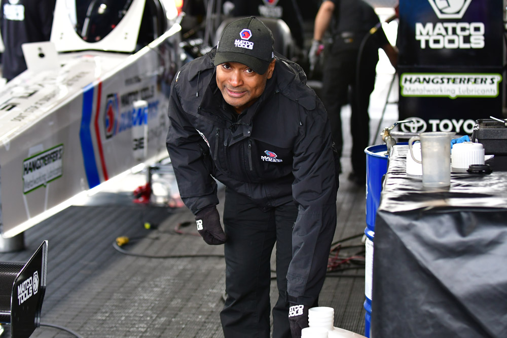Former Top Fuel champ and fan favorite Antron Brown fuels up his Matco dragster. Brown would lose a close first round matchup with teammate Leah Pritchett.