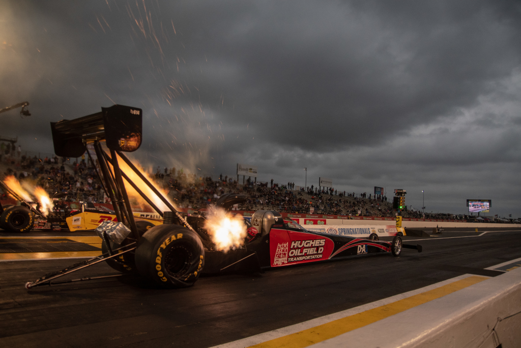 Sparks fly when Shawn Reed leaves the line during Friday night Top Fuel qualifying.