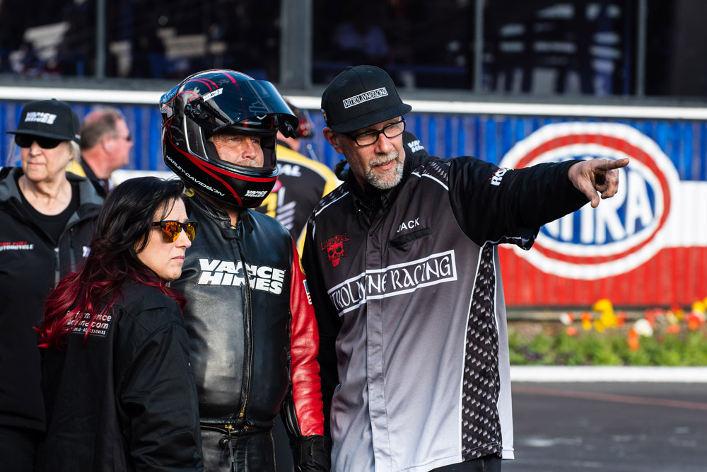 Luling native Angelle Sampey surveys the track conditions with new teammate and eventual Top Fuel Harley winner Doug Vancil. Sampey will get her season started when Pro Stock Motorcycle competes at the Gatornationals later this year.